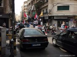 シリアのアサド政権を支持するデモ。